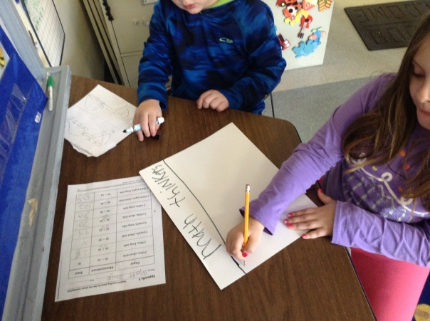 These mathematicians began making a poster to show their thinking for addition problems.