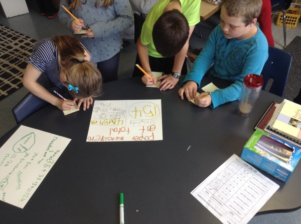 These mathematicians took a gallery walk and wrote compliments and questions on other mathematicians' posters.
