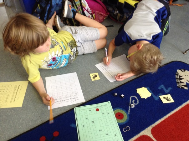 Ethan and Alec played Leapfrog during math, a game to support understanding of place value.