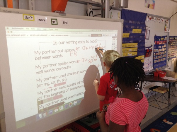 As each first grader completed one part of their checkup on a peer's writing, they wrote their initials on the checklist on our ActivBoard.