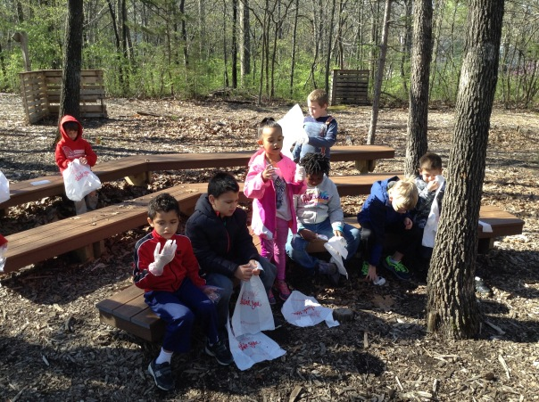 Our first grade scientists got ready to head into the woods to collect materials for their nests.