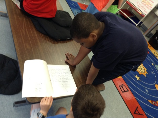 Isaiah shared his writing with a fourth grade learning buddy.