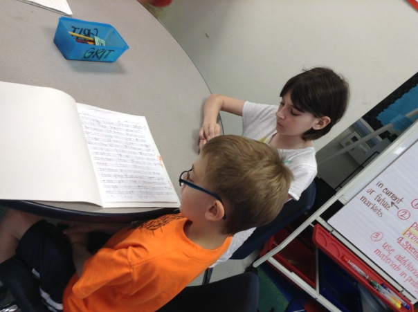 Gus shared his writing piece with a fourth grade learning buddy.