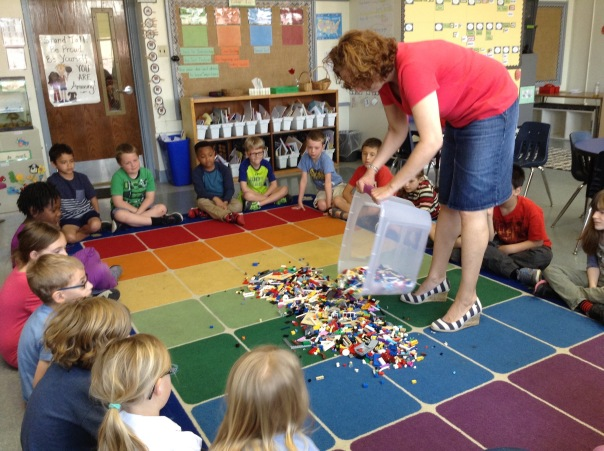 Whoa! Mrs. Sisul poured out 3000 Legos in front of our first graders.