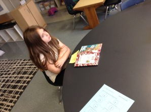 Jamie is taking time to PAUSE during her reading to PREDICT. This is a skill that good readers use while they read.