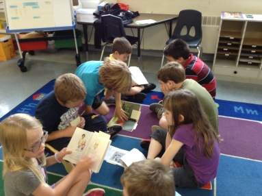 First grader retell stories to one another.