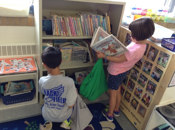 Addie and Kai checked out our library to fill their book bags!