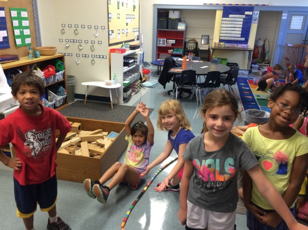 Look at these proud mathematicians and their LONG cube train!