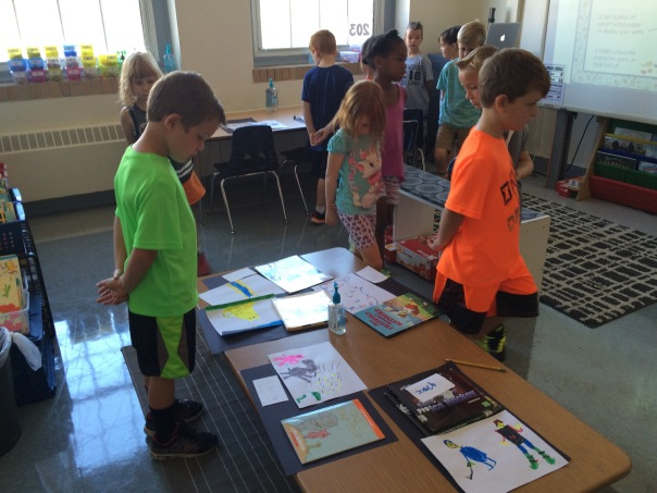 "Our first graders worked together to take a ""gallery walk"" during our book museum, in which each first grader featured a favorite book to showcase to our class."