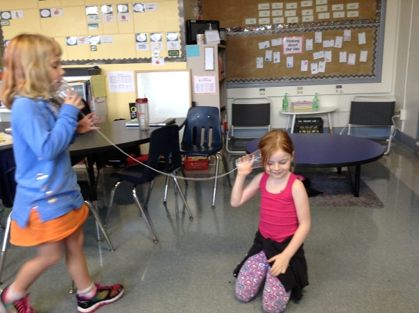"Amelia and Edie used ""telephone"" cups to explore sound."