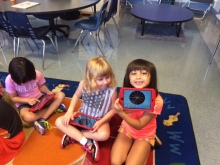 Happy first graders exploring their iPads!