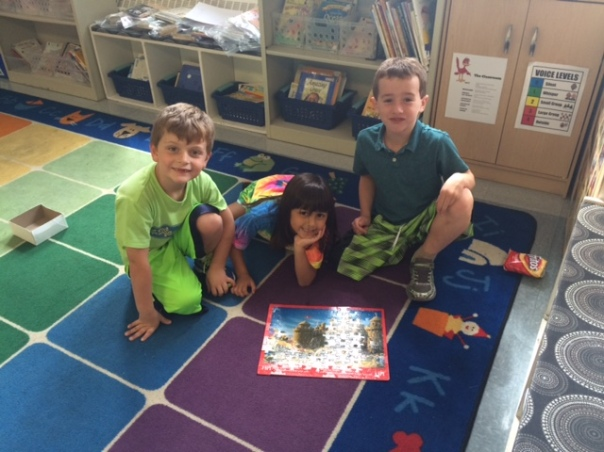 Look at how happy these first graders are after completing their 100 piece (!) puzzle!