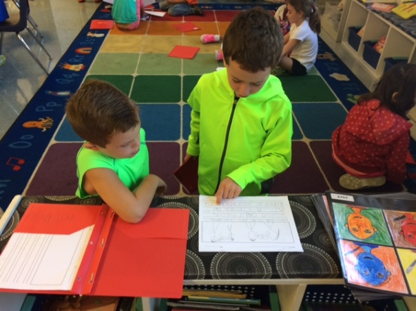 Trip and Connor read their stories to one another to strengthen their writing.