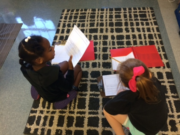 Autymn and Edie read their stories to one another as writing partners.