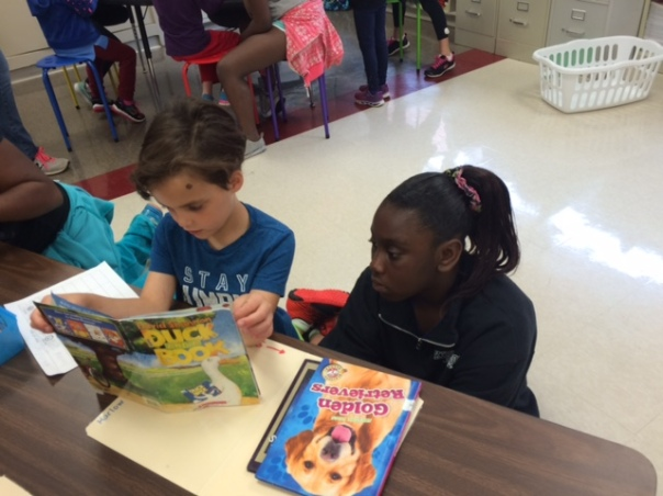 Harlow and her fourth grade buddy read together.