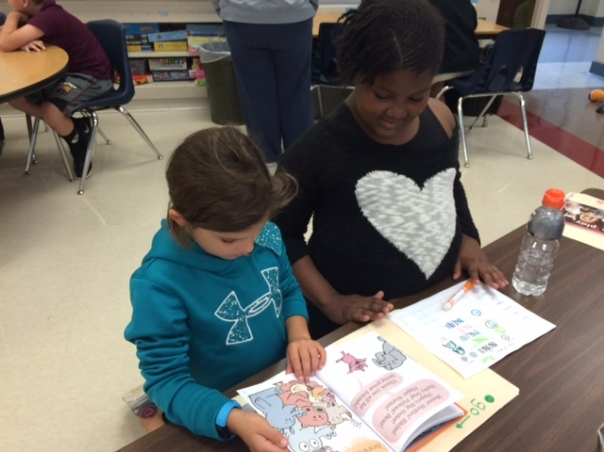 Ava read with her fourth grade buddy.