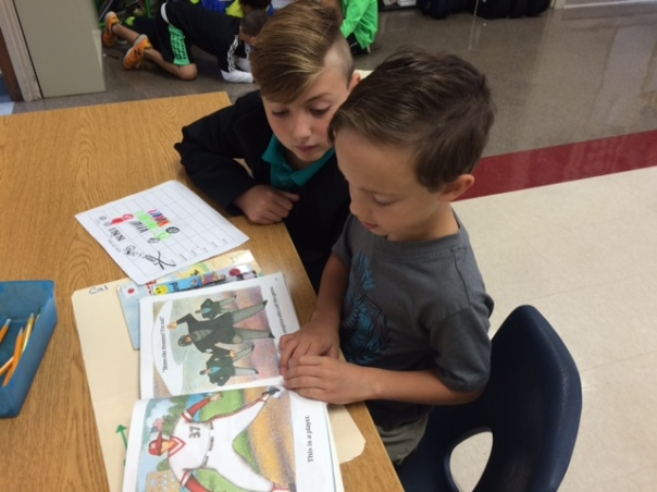 Cal and his fourth grade learning buddy read together.