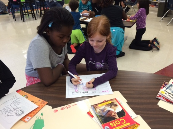 Edie worked on setting a reading goal for the day with her fourth grade learning buddy.