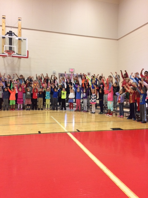 Check out the first graders rehearsing for our Veteran's Day Celebration!
