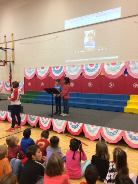 Two first graders practiced their speaking parts that will take place during the celebration.
