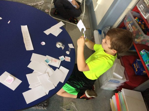 Connor worked to make his fraction shape game during our math time.
