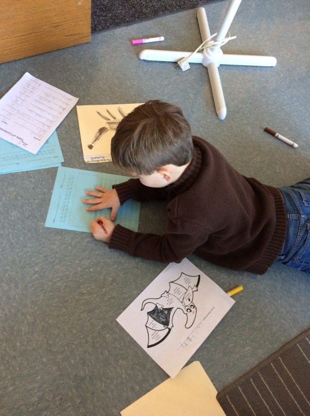 Zach worked on his dinosaur book with his editing coloring sheet.