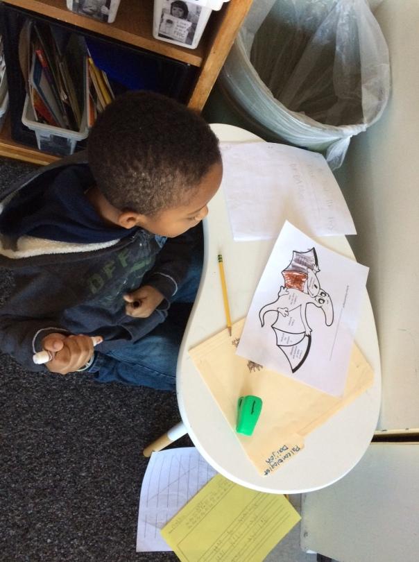 Dai'jon worked hard to edit his dinosaur book with his editing coloring sheet.
