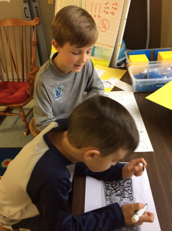 Cal and Charlie worked on a strategy to figure out how many books we have read this year.