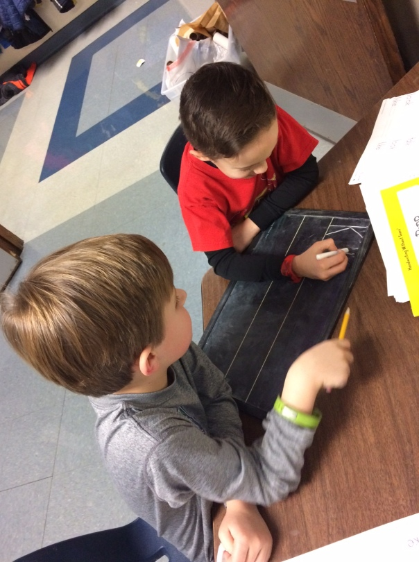 These first graders worked on their handwriting too - teaching one another how to make their best letters!