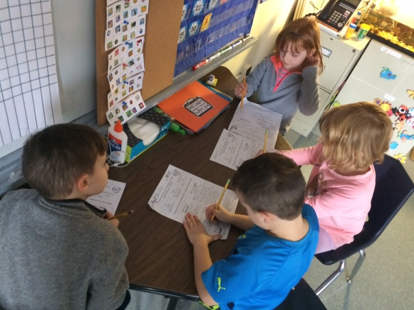 As these first graders worked on their planning sheet - they had a first grade teaching guiding them with ideas to talk about with their family at conferences.