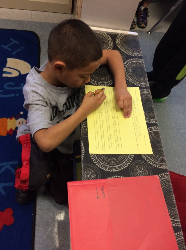 One of our hard-working authors as he wrote his persuasive piece.