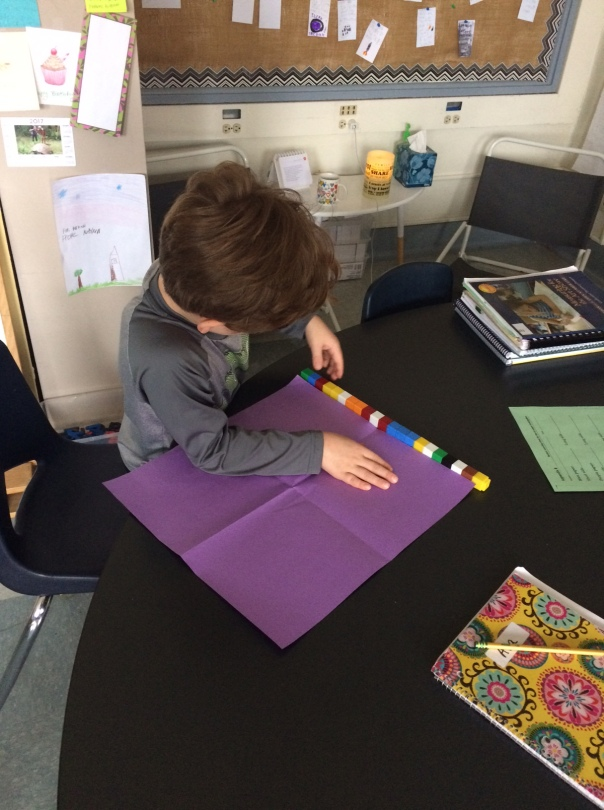 During our first day of measuring posters for our display of books, we used multicolored cubes and counted by ones.