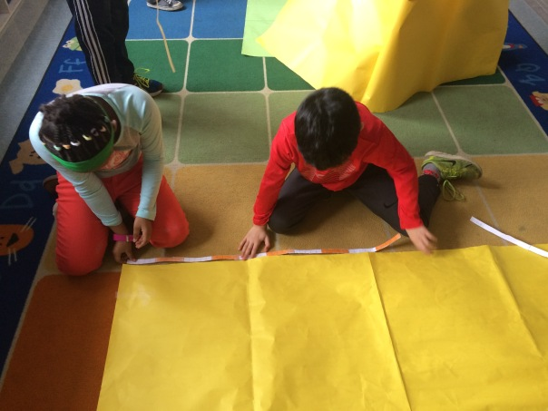 Check out these mathematicians as they used their tens strips to measure the yellow paper.