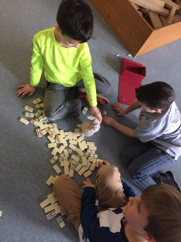 Here are some friends playing dominoes during our Global Play Day.