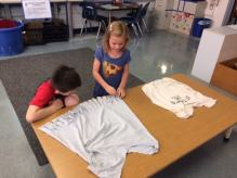 Here are some first grader making their t-shirt book bags.