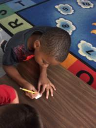 """Each first grader made a """"tile"""" to teach other GRA participants about us."""